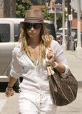 http://img139.imagevenue.com/loc892/th_90327_Ashley_Tisdale_leaving_Coffee_Bean_in_Los_Angeles_290708_01_123_892lo.jpg