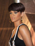 Rihanna shows her nipple piercing wearing sheer black top at the Much Music Video Awards in Toronto